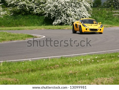 vintage cars racing around sprint racetrack