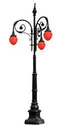 Vintage cast iron lamppost with red light isolated on white background