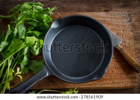 Vintage cast iron skillet on rustic wood background with vegetable prepare for cook #278561909