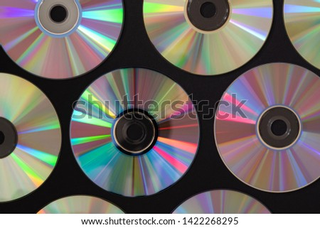 Vintage CD or DVD disk background, old circle discs used for data storage, share movies and music