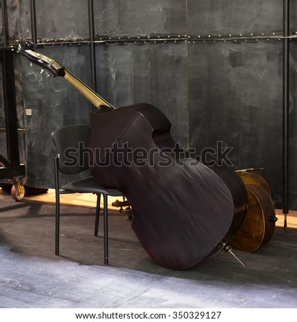 Vintage cello on wooden background #350329127