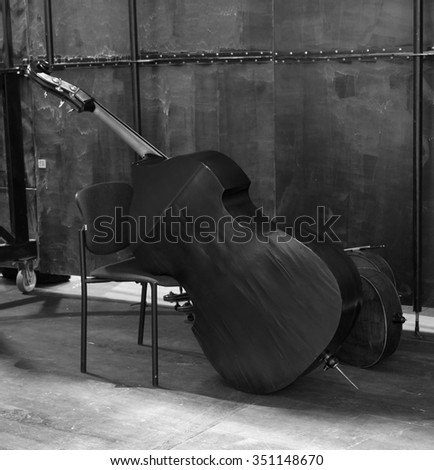 Vintage cello on wooden background. black and white photo #351148670