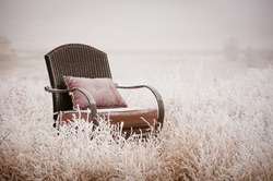 Vintage chair on a morning frost after a night of snow