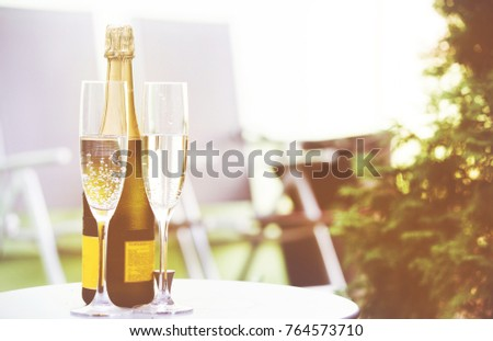 Vintage champagne glasses background. New Year garden party #764573710