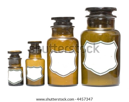 vintage chemical bottles of different sizes