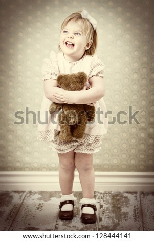 vintage child hugging her teddy bear