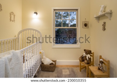 Vintage children bedroom / kids room with beige walls, carpet, chairs and bed