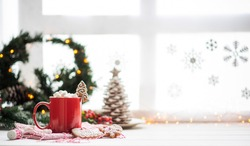 Vintage Christmas background. Christmas breakfast and decoration against winter window. Cup of coffee, coffee pot and gingerbreads. Christmas family morning. Copy space for your text.