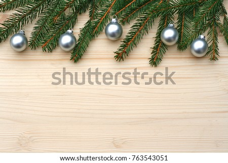 vintage Christmas background with fir branches and silver balls on wood #763543051