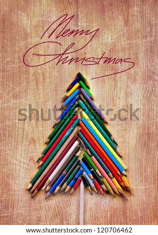 vintage christmas card whit colorful pencils  as christmas tree /xmas concept/original christmas background with pencils
