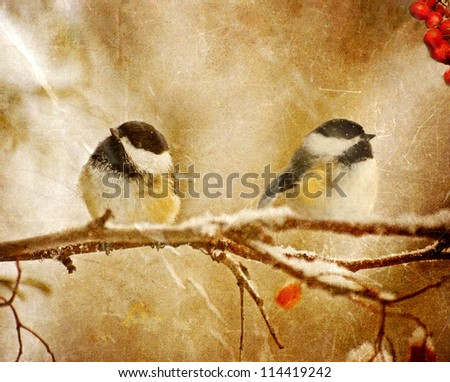 Vintage Christmas card with adorable chickadees in the snow with copy space.