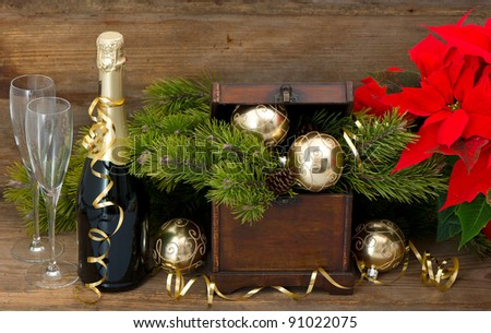 vintage christmas decoration. bottle of champagne and two glasses over wooden background