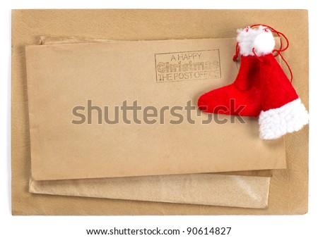 vintage christmas envelope and postcard. santa's hat and sock - stock photo