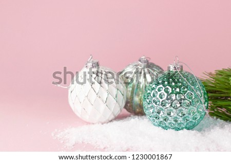 Vintage Christmas New Year balls in the snow and pine branches on pink background Flat Lay copy space. Holiday Baubles, beautiful Decoration Festive decor, celebration Xmas holiday greeting card #1230001867