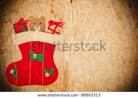 Vintage Christmas postcard with Christmas sock and teddy bear
