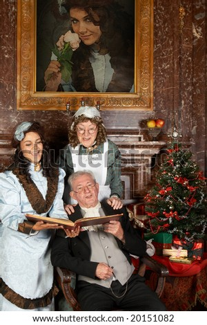 "Vintage christmas scene of a victorian family singing christmas carols. Shot in the antique castle ""Den Brandt"" in Antwerp, Belgium (with signed property release for the Castle interiors)."
