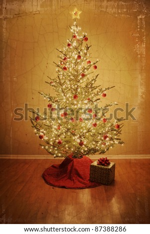 Vintage Christmas tree with red ball ornaments and present