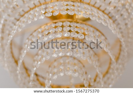 vintage classic chandelier. Chrystal chandelier close-up in the dark. Glamour background