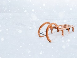 Vintage classic wooden sled for snow riding and sledding - winter fun and games