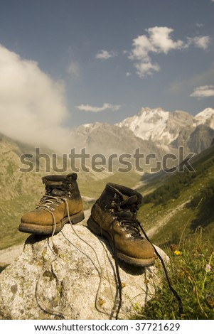 Vintage climber boots are dried in the base camp in mountains