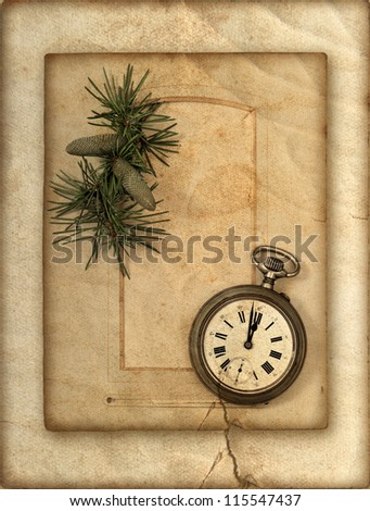 vintage clock and christmas tree brunch over grunge paper background. card concept