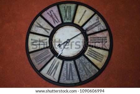 Vintage clock on a dark red wallpaper Stock foto ©
