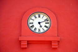 Vintage clock on an old stucco wall. Tower clock.