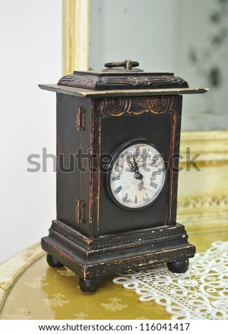 Vintage clock on table.Wooden clock