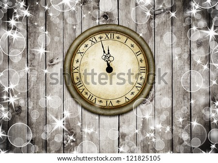 Vintage clock on the brown wood texture with white snow and stars. Christmas background