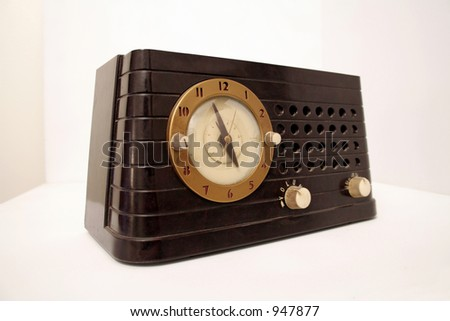 Vintage clock radio set against a white background
