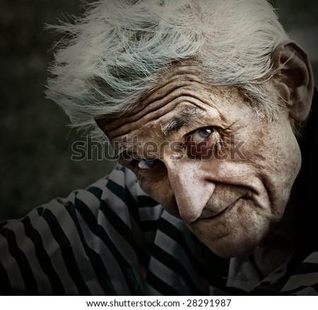 Vintage closeup portrait of senior man with wisdom smile