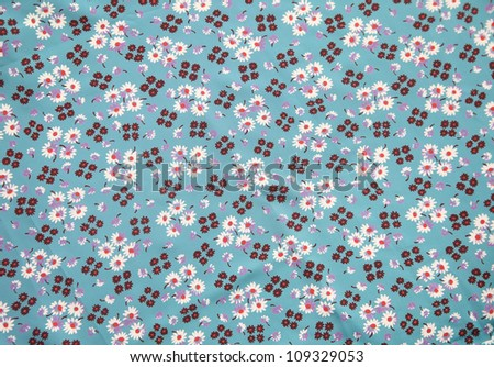 vintage cloth with flower print in blue, brown, lilac and orange