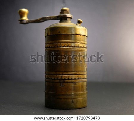 Vintage coffee grinder close up in black background Stok fotoğraf ©