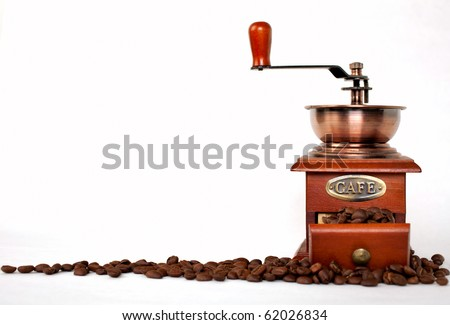 Vintage coffee grinder with coffee beans