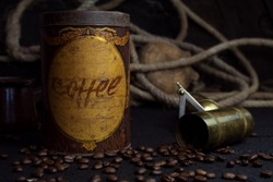 Vintage Coffee Tin Canister and Grinder With Coffee Beans On a Rustic Background