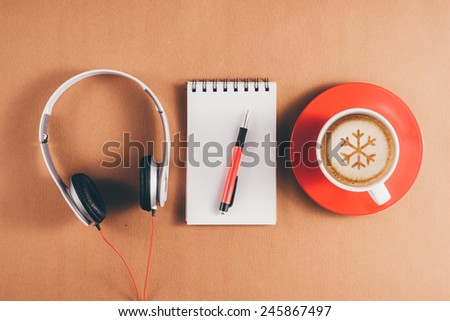 Vintage color. blank paper or notebook and cup of coffee on green wooden desk. Simple workspace or coffee break with relaxing composing. View from above