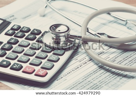 Vintage color of Health care costs. Stethoscope and calculator symbol for health care costs or medical insurance