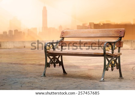 vintage color tone style of wooden bench antique with sunrise on flat top of a roof, soft focus