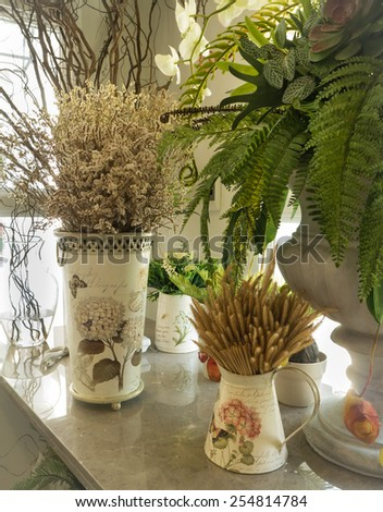 Vintage color with Dried flower in vase place on table