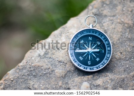 Vintage compass lying on the floor. Adventure and discovery concept.