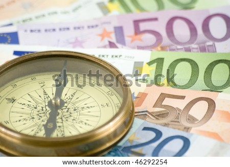 vintage compass on money background