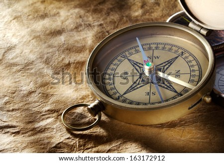 Vintage compass on paper background