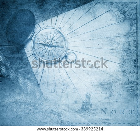 Vintage  compass with nautical map background.