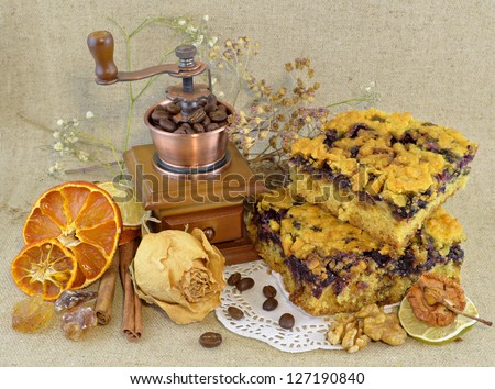 Vintage composition with pieces of pie and coffee grinder