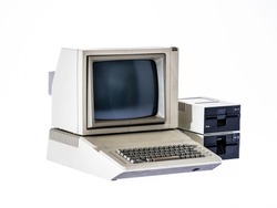 Vintage computer from the 80s on white background