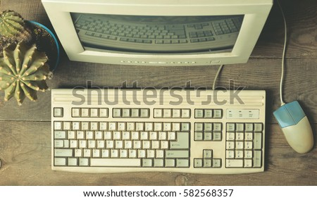 vintage computer on a wooden...