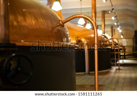 Vintage copper brewing kettles in modern brewery. Equipment for production of craft beer Stock photo ©