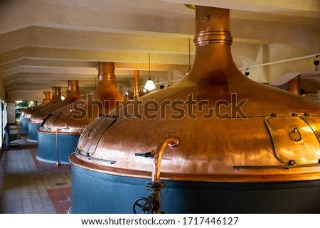 Vintage copper brewing kettles in modern brewery. Equipment for production of craft beer ストックフォト ©