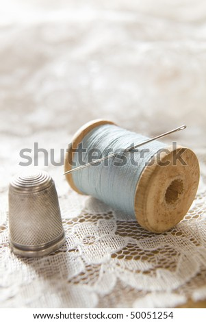 vintage cotton reel with needle ...