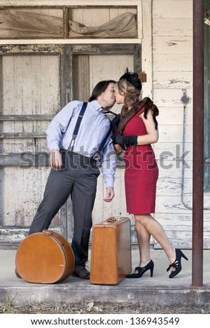 vintage couple kissing while waiting for bus